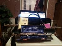 Gemeinhardt flute and piccolo. Flute is open-hole. Also