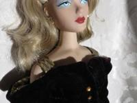 I am selling a Gene Collectible Doll created by Mel
