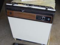 This is a 1980's vintage General Electric Dishwasher.