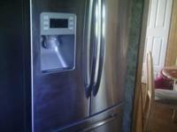 GE PROFILE FRENCH DOOR REFRIGERATOR FOR SALE. LIKE NEW,