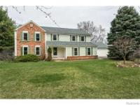 This Stately Brick/Vinyl 2-story Is Nestled On A