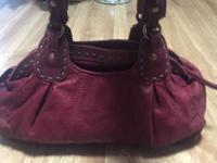 I'm selling my gently used Lucky Trinity handbag in the