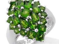 This is a Genuine Chrome Diopside Marquise Cluster Ring
