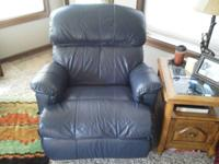 Like new, leather recliner, navy blue in color.  This