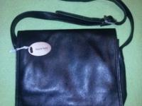 Very nice black leather purse with adjustable strap.