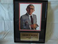 This is a mint conditioned framed photo of the late