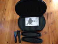 George Foreman indoor electric grill. With 2 drip pans
