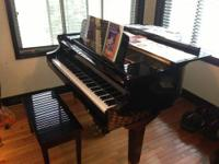 This beautiful baby grand piano is outfitted with