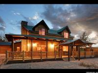 Get away to this magnificent log mountain retreat!