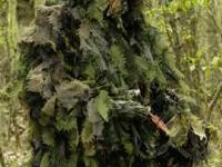 Description This unique ghillie suit is built like the