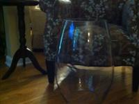 Large glass heavy. 20 inches tall; 10 inch opening at