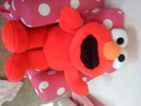 I am selling a clean giant plush Elmo doll. He retails