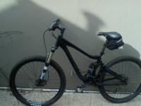 Black MTB, bought used from Trips for Kids in San