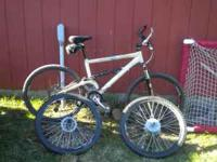Customized Mens mountain bike with extra set of rims.
