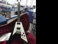 I am selling an Ebony Gibson Flying V Electric Guitar