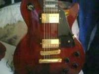 wine red w/gold hardware excellent condition comes with