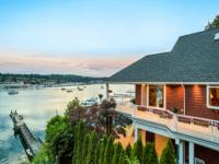 Statement waterfront estate home with views of charming