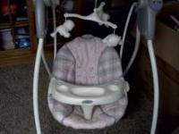 Perfect condition. Pink/gray plaid. If interested call