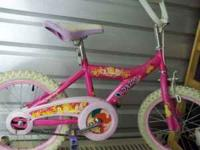 Real cute hot pink and white bike with helmet. Has new