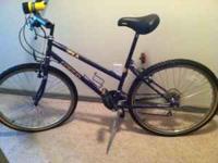 Purple bike w/ kickstand, water bottle cage, and