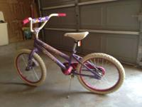 Pretty purple & white huffy bike. Back-pedal brakes.