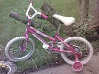 Girl's bike for sale, with training wheels. $25.00 in