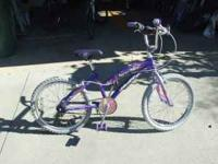 Bike is for 6-8 year old; no gears, purple Huffy, and