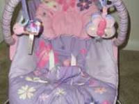 Purple and pink bouncer seat with pretty butterfly and