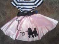 Girl's 50's poodle skirt Halloween costume. Worn only