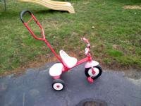 Up for sale is a gently used girl's RadioFlyer tricycle