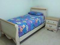 Beautiful girl's twin sleigh bed and night stand both