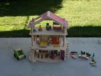 Wooden doll house for sale that has hardly ever been
