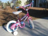 "Girls very rarely used 12"" sea star huffy bike. Bought"