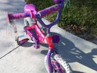 Girls Barbie Bike with Training wheels. Pink with the