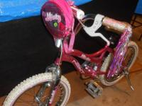 Great girls starter bike. Pink and white with streamers