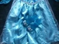 4T Disney Frozen Elsa dress showing some wear. Tearing