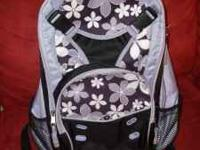 This is a purple flowery back pack that has ipod