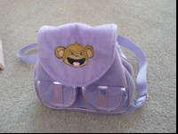 Girls backpack with a monkey on the front and two