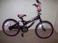 Girls pink and black bike, great condition. call Sam