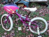 Little girls bike with training wheels. It's rusty but