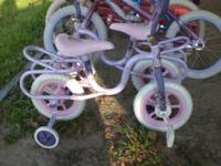 2 Huffy girls little Bikes with training wheels & 2