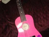 Childs wooden Guitar 20.00 OBO must go text me at