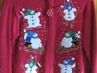 Girls size 8/10 Medium. Red with snowman motif. Gently