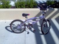 Purple Mongoose girl 20 in bmx bike