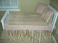 The bedding in the picture is for sale that is stripes