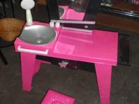 This is a plastic girl's vanity with a stool.  It has a