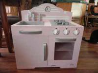Girls pink wood play kitchen in great condition comes