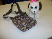 really cute stuffed dog that goes in the purse or use