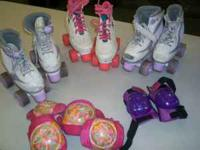 used girls roller skates. 2 of them are size 1 and the