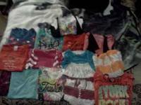 14 girls shirts, mostly from justice and Kohl's brand